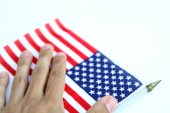 Hand over a us flag. isolated — Stock Photo