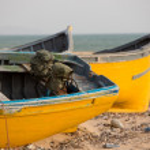 Two Colored fishing boats on the beach of Sidi Kaouki — Stock Photo #53424281