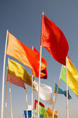 Flags of Morocco waving against blue sky — Stock Photo