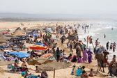 Beautiful beach full of vacationing people , Morocco — Stock Photo