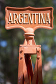 Red train station post sign with Argentina in capital letters — Stock Photo