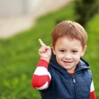 Smiling little boy pointing to copyspace — Stock Photo #59105685
