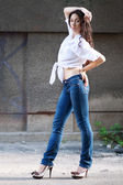 Woman in jeans posing — Stock Photo