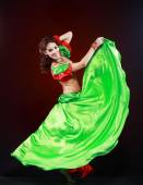 Woman dancing in green and red costume — Stock Photo