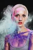 Girl with colored powder — Stock Photo