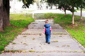 Boy walking away — Stock Photo