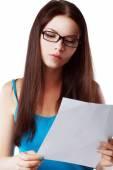 Woman reading document — Stock Photo