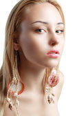 Woman with Shell earrings — Stock Photo