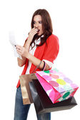 Woman looking at her receipt — Stock Photo