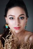 Young woman wearing an earrings — Stock Photo