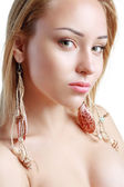 Peculiar Woman with Shell earrings — Stock Photo