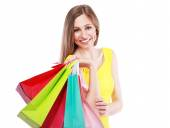 Woman holding bags — Stock Photo