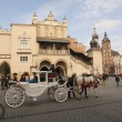 KRAKOW, POLAND - March 29, 2015: Horse carriage on the streets o — Stock Photo #68881353