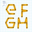 Letters E, F, G, H on a blue graph paper — Stockvektor