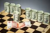 Ruble and dollars on chess board - closeup — Stock Photo