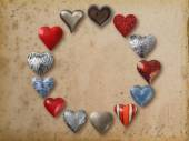 Metal heart shaped things arranged in circle — Stock Photo