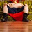 Luchador sitting on a couch — Stock Photo #64460407