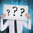 Man cover face with question board — Stock Photo #63330071