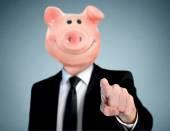 Piggy bank head business man — Stock Photo