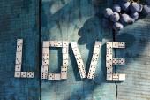Word love of wooden dominoes — Stock Photo