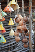 Lots of hanging clay pots and bells — Stock Photo