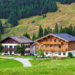 Beautiful typical mountain guests houses on austrian alps — Stock Photo #55968813