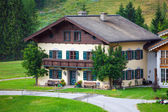 Beautiful typical mountain guests house on austrian alps — Stock Photo