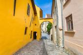 Old stone paved street with tourists from Sighisoara fortress — Stok fotoğraf