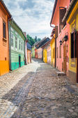 Stone paved old streets with colored houses from Sighisoara fort — Stock Photo