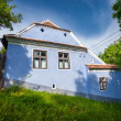 Blue painted traditional house from Viscri village in Transylvan — Stock Photo #73895749