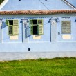 Blue painted traditional house with green shutters from Viscri v — Stock Photo #74083003