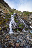 River watterfall flowing over rough rocks — Stock Photo