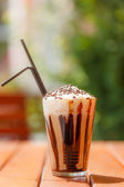 Iced coffee with whipping cream — Stock Photo
