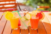 Fresh juices in glasses, outdoors — Stock Photo