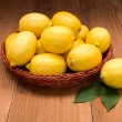Fresh lemons in wooden tray — Stock Photo #58286551