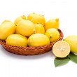 Fresh lemons in wooden tray — Stock Photo #58286641
