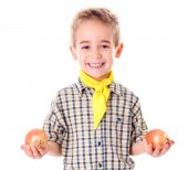 Little agriculturist holding onions — Stock Photo