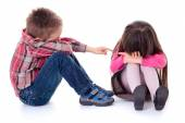 Angry sulking children pointing at each other — Stock Photo