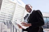 Black businessman documents handling — Stock Photo