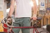 Stylish biker with vintage race bike — Stock Photo