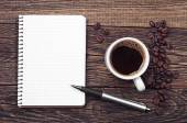Notepad and cup of coffee — Stock Photo