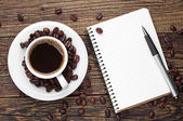 Coffee and notepad — Stock Photo