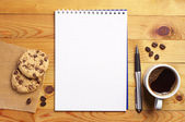Coffee with cookies and notepad  — Stockfoto