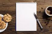 Notepad and coffee with cookies — Foto de Stock