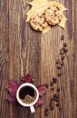 Cookies, coffee and autumn leaves — Stock Photo
