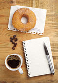 Coffee with donut and notepad  — Foto de Stock