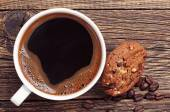 Closeup coffee and chocolate cookies — Stock Photo