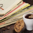 Coffee cup and old magazines — Stock Photo #56460645