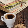 Coffee cup and old magazines — Stock Photo #56460653