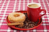 Plate with donut and coffee — Stock Photo